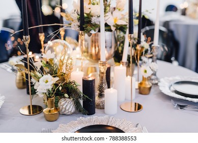 Closeup of reception table decorated for wedding or another catered event dinner