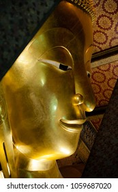 Close-up of the reclining Buddha at Wat Pho Temple, Bangkok, Thailand. The temple is first on the list of six temples in Thailand classed as the highest grade of the first-class royal temples.