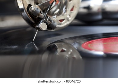 Close-up at record being played on a old gramophone