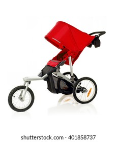 Closeup of red baby stroller isolated over white background