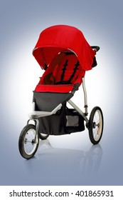 Closeup of red baby stroller isolated on blue background
