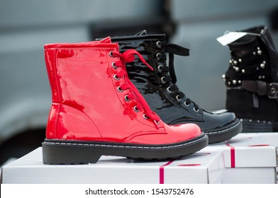 Closeup of red and black boots at the market