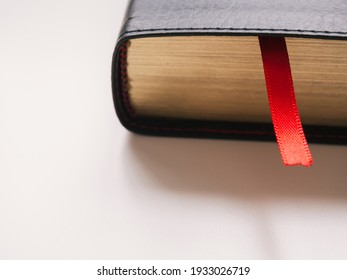 Close-up red bookmark with copy space. Book day concept