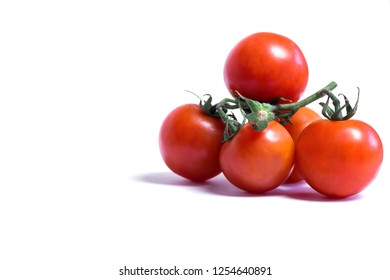Close-up of Red Cherry or Cocktail Tomatoes isolated on white Background.