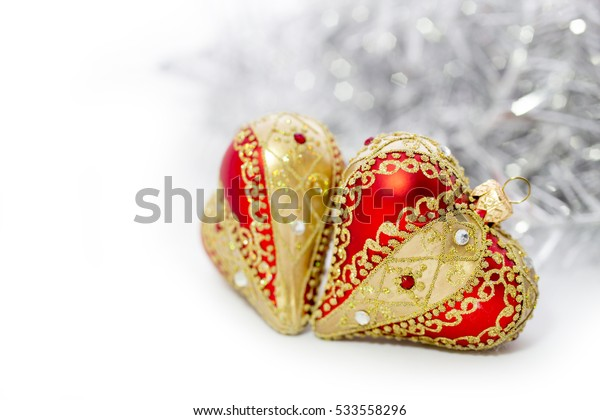 Closeup of red Christmas balls heart and on white background