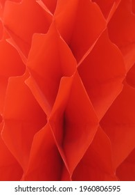 close-up of a red colored honey comb ball used as decoration