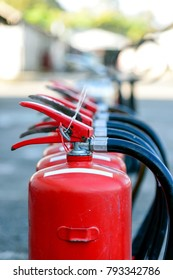 closeup red fire extinguisher with soft-focus and over light in the background