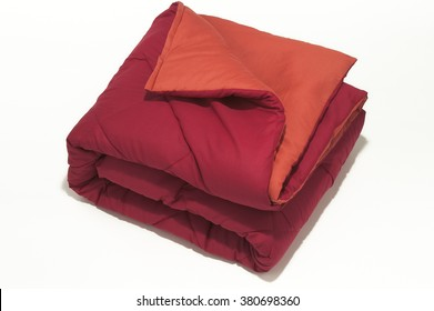 Closeup of red folded blanket on white background