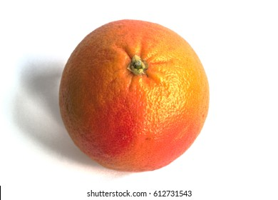 Closeup of a red grapefruit on a white background