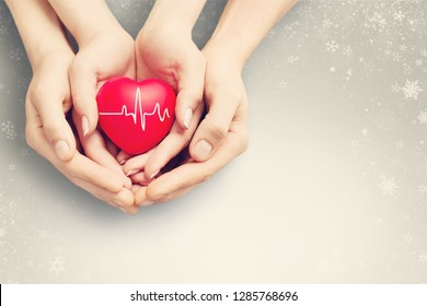 Close-up red Heart in hands, love concept