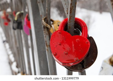 Close-up red heart valentine vintage  lock on the bridge in winter. Bridge of lovers in a city park .  Zvenigorod city. Moscow. Russia.