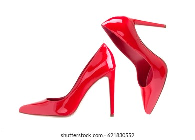 Closeup of red high heels on white background