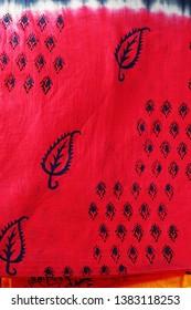 Closeup of a red Kalamkari saree  showing block printed designs.