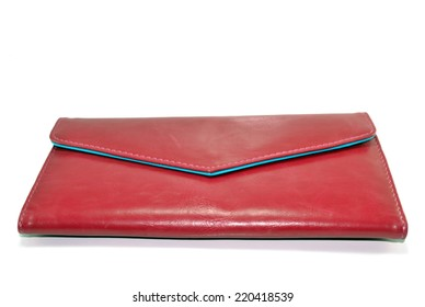 Closeup of a red leather wallet isolated on white background