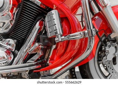 Closeup of red motorcycle. Beautiful modern red motorcycle headlights details.