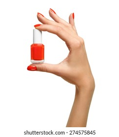 closeup of red nail polish in the hand of
