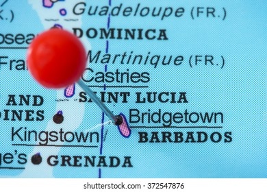 Close-up of a red pushpin in a map of Bridgetown, Barbados.