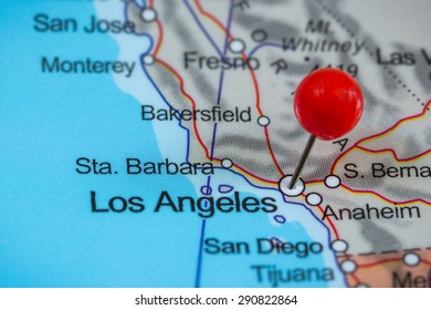 Close-up of a red pushpin on a map of Los Angeles, USA