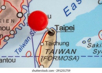 Close-up of a red pushpin on a map of Taipei, Taiwan