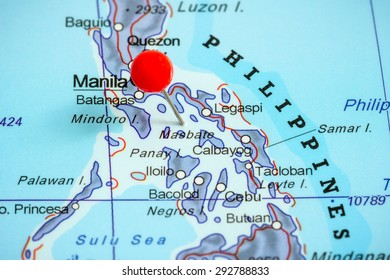 Close-up of a red pushpin on a map of Philippines