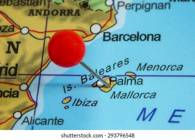 Close-up of a red pushpin on a map of Mallorca, Spain