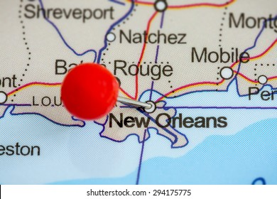 Close-up of a red pushpin on a map of New Orleans, USA