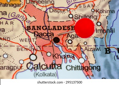 Close-up of a red pushpin on a map of Bangladesh