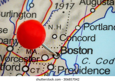 Close-up of a red pushpin on a map of Boston, USA