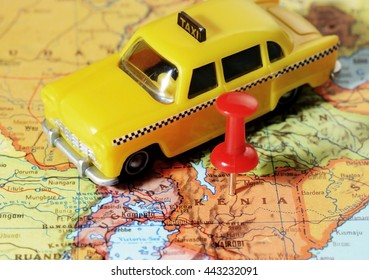 Close-up of a red pushpin on a map of Kenia  Africa and a taxi car - travel concept