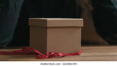 Closeup red ribbon and gift box
