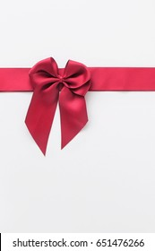Closeup of red ribbon on white background, holiday and event concept and decoration idea