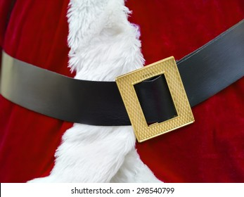 Closeup of a red Santa Claus costume with belt and buckle