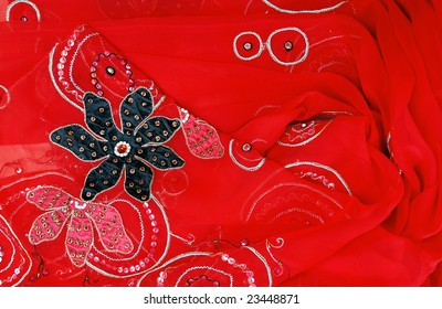 A closeup of red sari