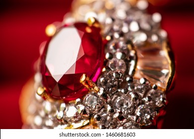Closeup of a Red Siamese ruby ring with diamonds surrounded on it with a beautiful red background, Macro photo of a Red Ruby diamonds ring.