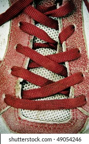 closeup of a red sneaker with red laces