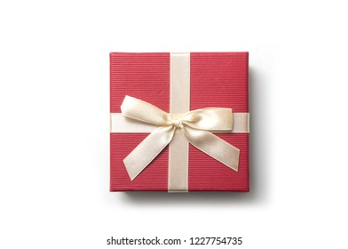closeup of red square paper box with golden ribbon on white background
