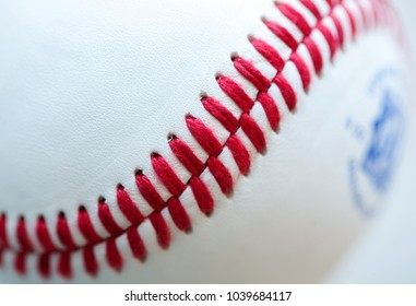 Closeup of the red stitching on a baseball