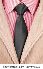 Close-up of red striped shirt with black tie