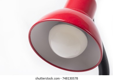 Closeup of red table lamp isolated on a white background.