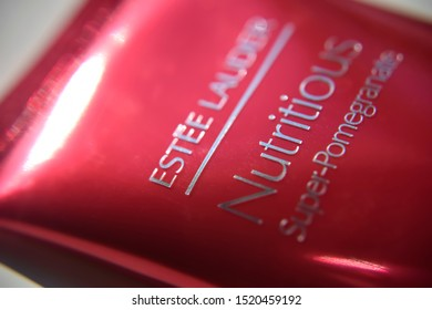 close-up red tube of cleansing foam Nutritious super-pomegranate by Estee Lauder