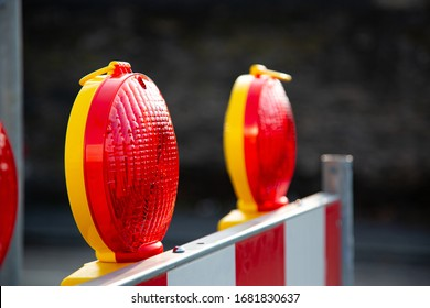 Close-up of red warning lights with street barriers at a construction site