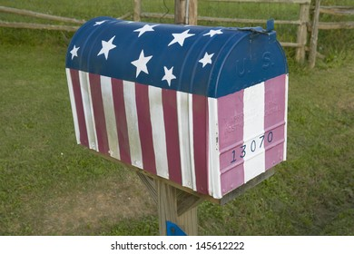 Close-up of red white and blue US flag mailbox in central GA