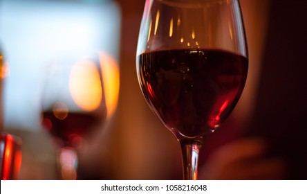 closeup of red wine glass on table in restaurant