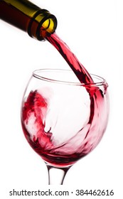 Closeup of red wine pouring into glass