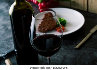 Closeup of Red Wine and Steak Dinner