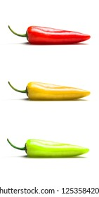 Close-up of Red, yellow and green hot peppers vertically among each other isolated on white background.