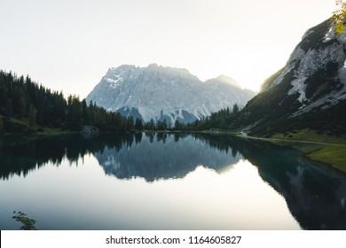 Close-up of reflection lake Seebensee and mount Zugspitze seen from Coburger Hut, an alpine hut near Ehrwald, Tyrol, Austria