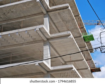 Closeup of a reinforce concrete frame structure of a new multi-story apartment building in construction showing slabs, beams and columns