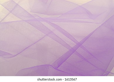 Closeup of a remnant of purple netting
