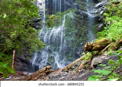 Closeup of remote and desolate Yalynskyi waterfall with water drops falling against rocky slope.